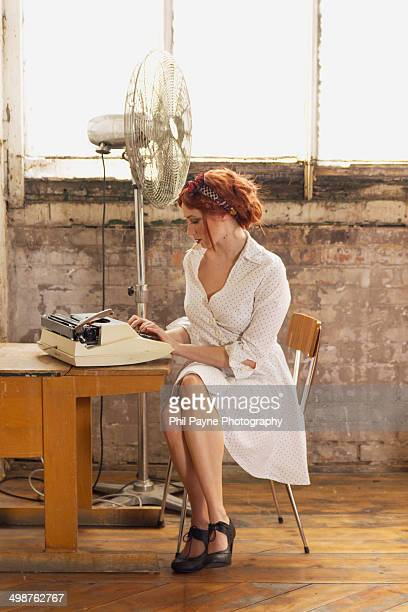 Young woman in old office typing