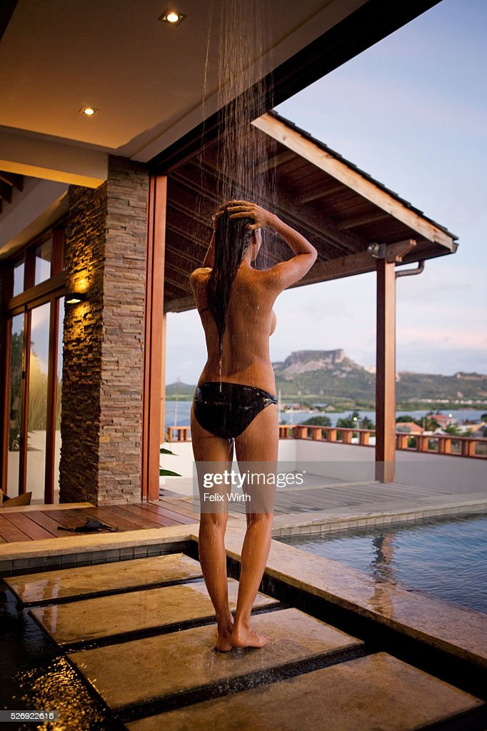 Young woman in outdoor shower : Stock Photo