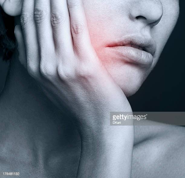 Young woman in pain is having toothache