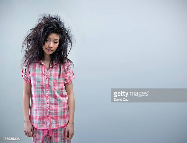 Young woman in pajamas and messy hair, portrait