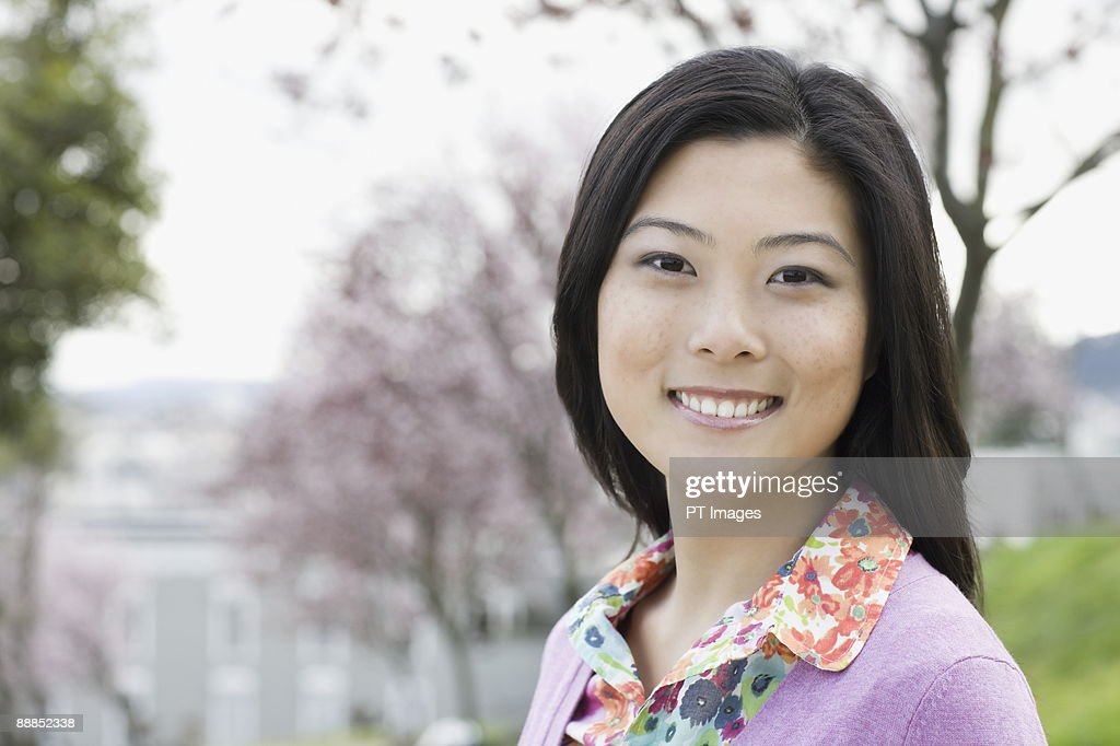 Young woman in park, portrait : Stock Photo