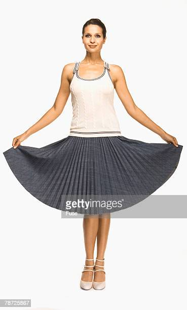 Young Woman in Pleated Skirt