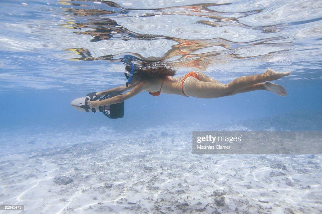 young woman in red bikini snorkeling : Stock Photo