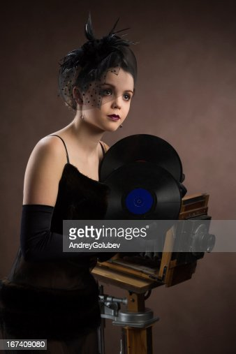 Young woman in retro style with vinyl plate : Stock Photo