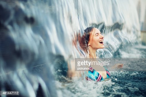 Young Woman in Rooftop Pool