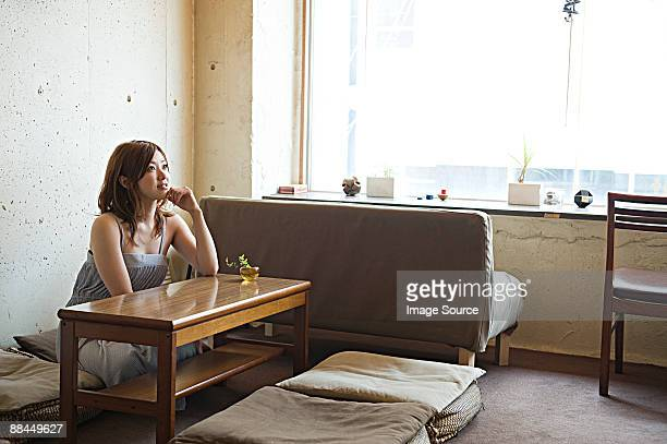 Young woman in room