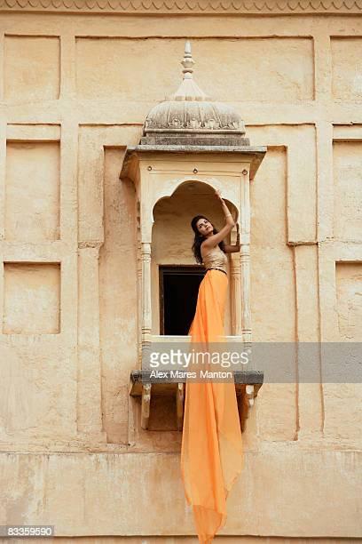 young woman in sari, on balcony