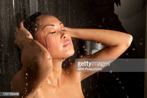 Young woman in shower : Stock Photo