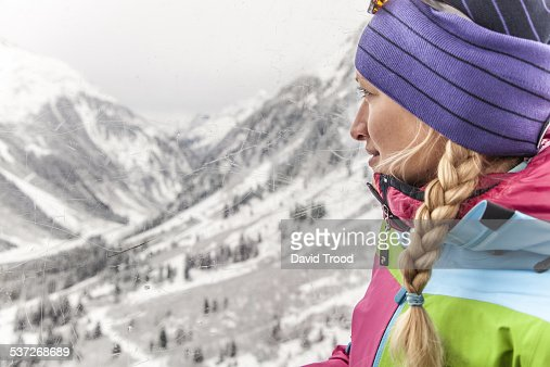 Young woman in ski lift in the Austrian Alps