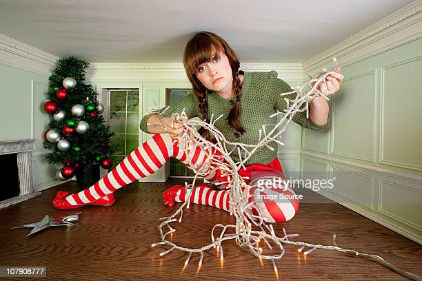Young woman in small room with christmas lights