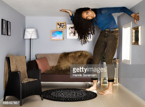 young woman in small scale living room
