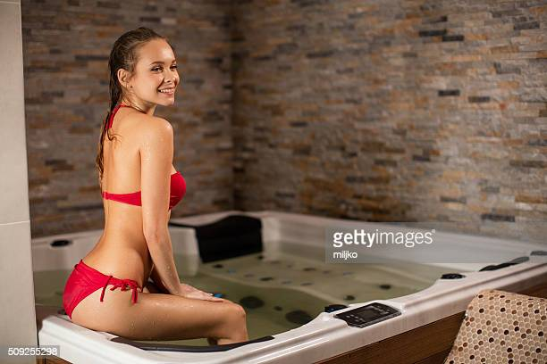 Young woman in spa bath