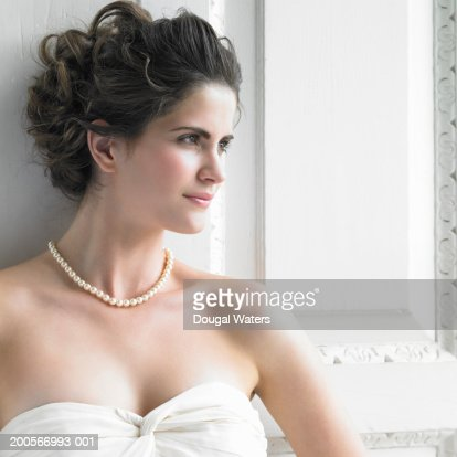 Young woman in strapless dress, head and shoulders