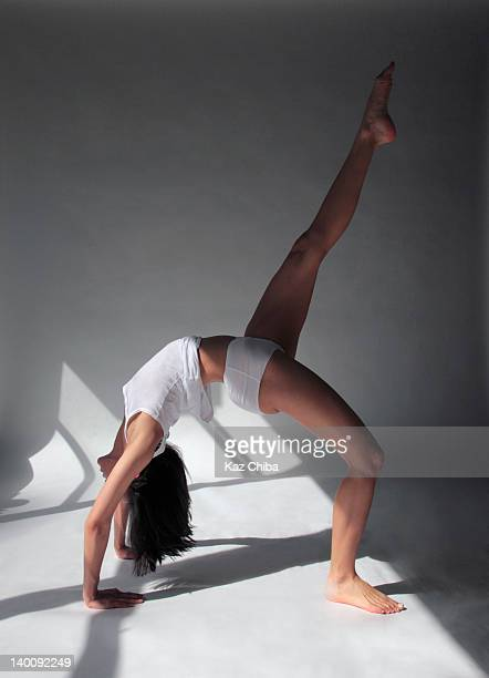 Young woman in stretch exercise.