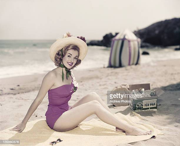 Young woman in swimwear at beach, portrait, smiling