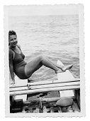 Young woman in swimsuit on a little boat in 1939