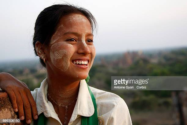 A young woman in the Bagan Valley She is wearing Thanaka on her face All over Myanmar Burmese are using Thanaka a bark paste that the locals use for...