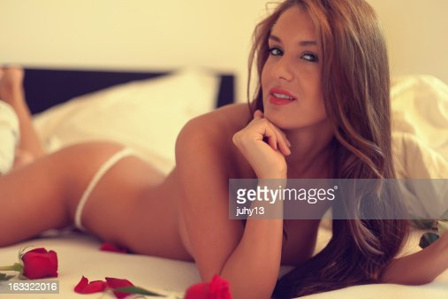 Young Woman In The Bed Stock Photo | Getty Images