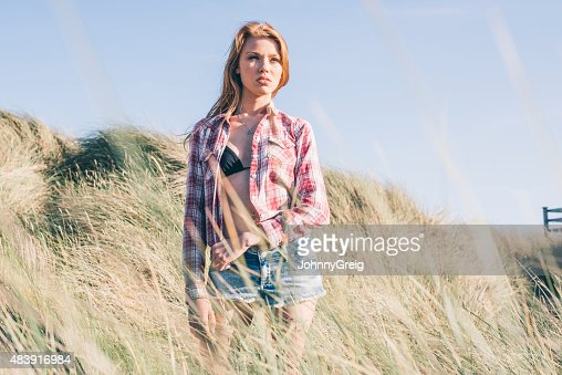 Young woman in the dunes