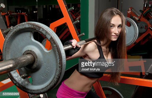 Young woman in the fitness center : Stock Photo
