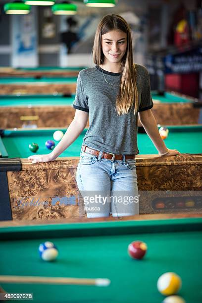 Young woman in the pool hall