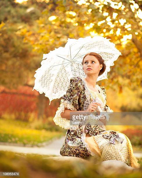 Young woman in the rays of autumn sun