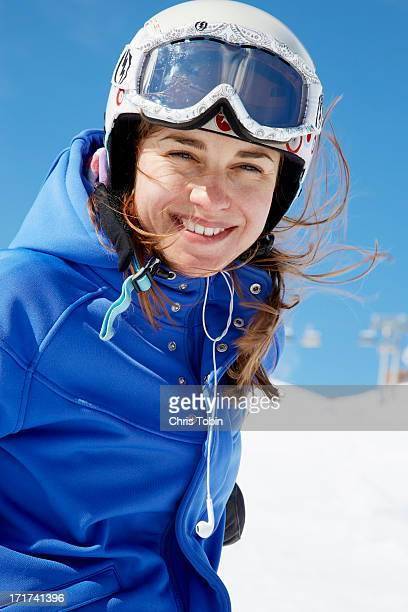 Young woman in the snow with ski gear