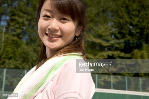 Young woman in the tennis court : Stock Photo