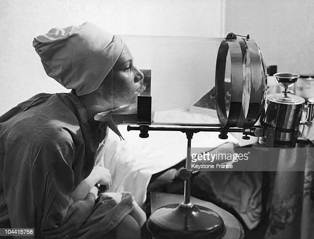 A young woman in the UnitedStates using a facial steamer to cleanse her skin
