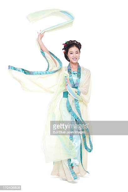 Young woman in traditional Chinese costume performing traditional dancing