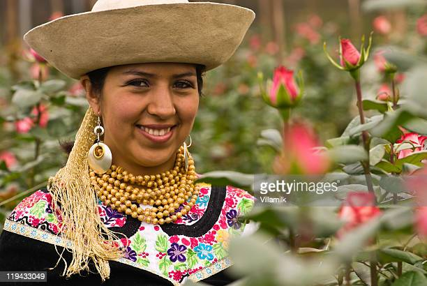 Young woman in traditional Ecuadorian dress with roses