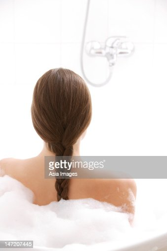 Young woman in tub : Stock Photo