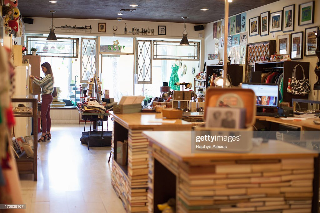 Young woman in vintage shop : Stock Photo