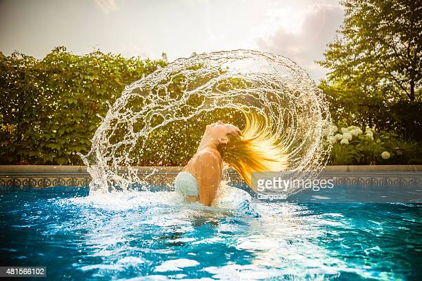 Young woman in water with hair splash