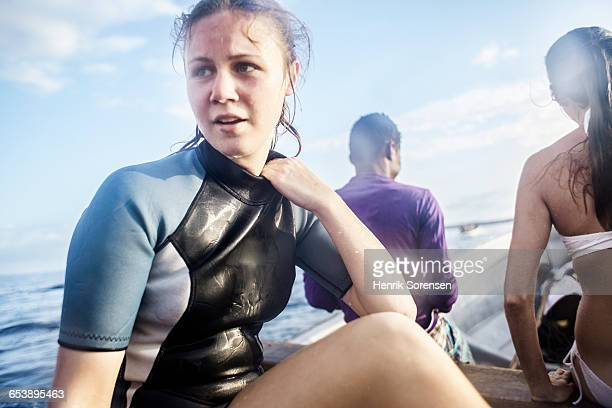 young woman in wetsuit