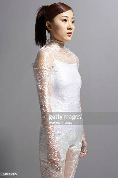 Young woman in white and plastic wrap