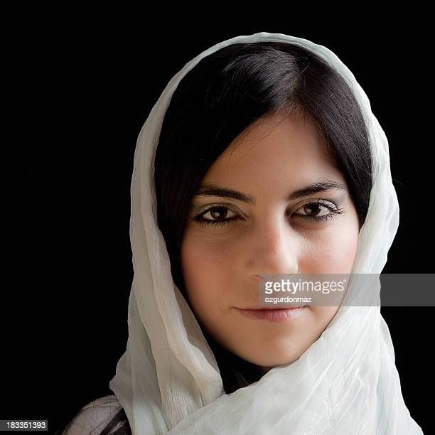 Young woman in white scarf