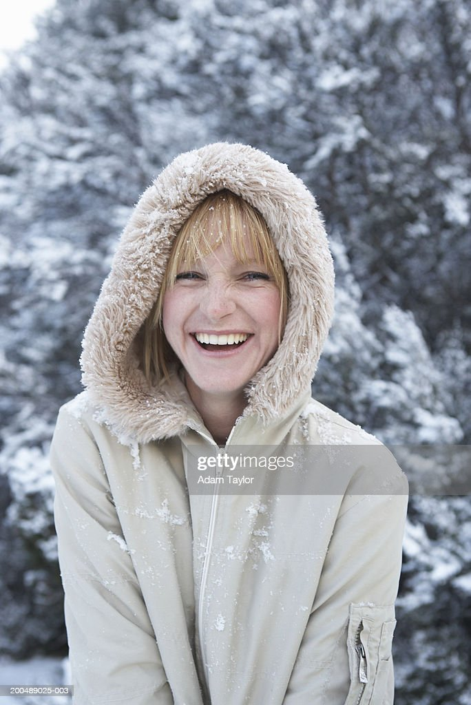 Young woman in winter coat, laughing, portrait : Stock Photo