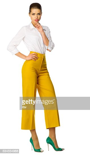 Young woman in yellow pants isolated : Stock Photo