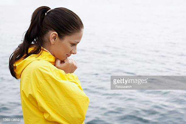 Young woman in yellow raincoat