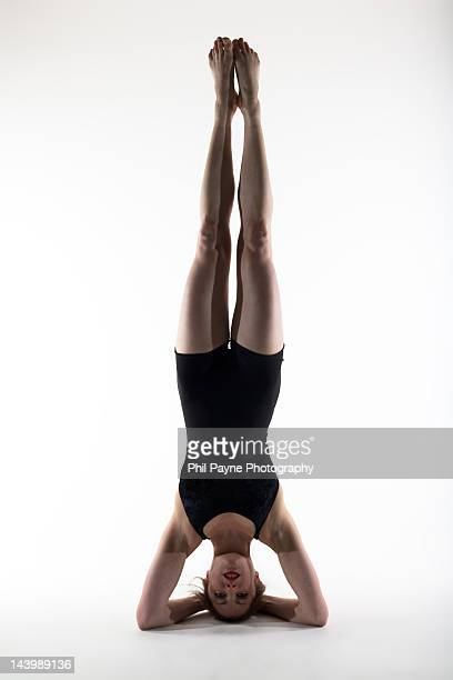Young woman in yoga headstand