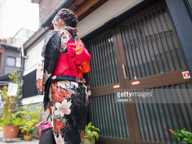 Young woman in yukata passing by