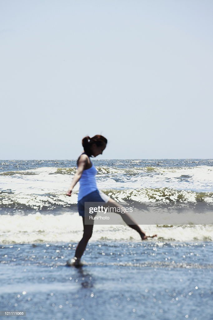 young woman into the sea : Stock Photo