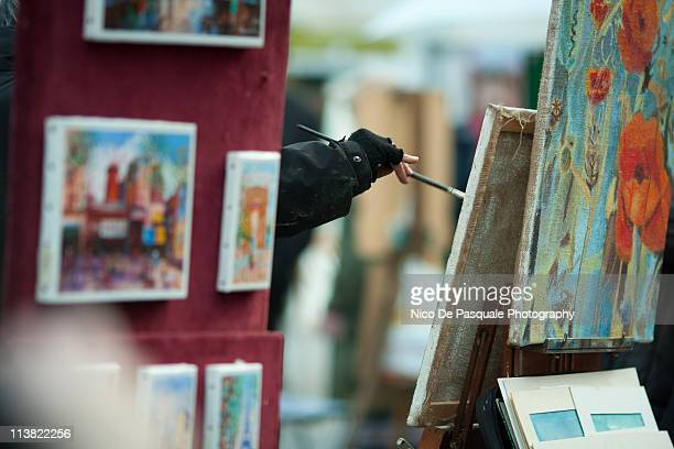 Young woman is artist she is painting