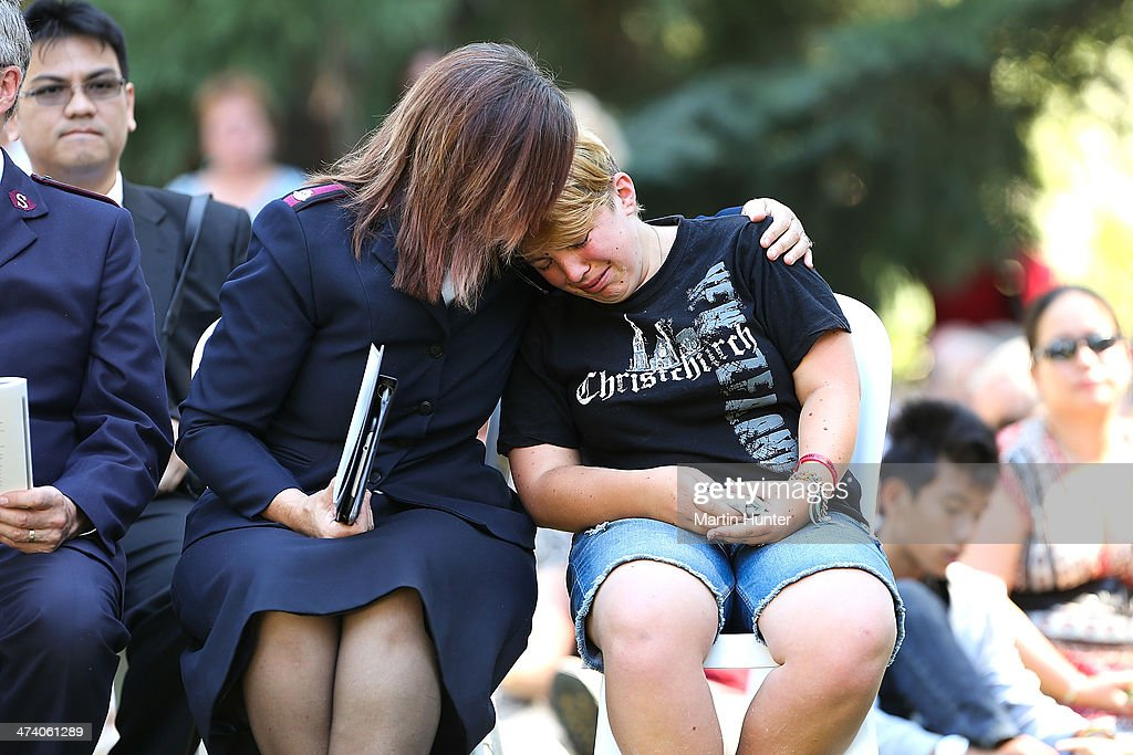 A young woman is comforted during a Civic Memorial Service held in the Botanical Gardens for victims of the 2011 Christchurch Earthquakes on February 22, 2014 in Christchurch, New Zealand. The earthquake measuring 6.3 in magnistude devastated Christchurch killing 185 people and causing an estimated $40 billion in damage to the city's buildings and infrastructure.