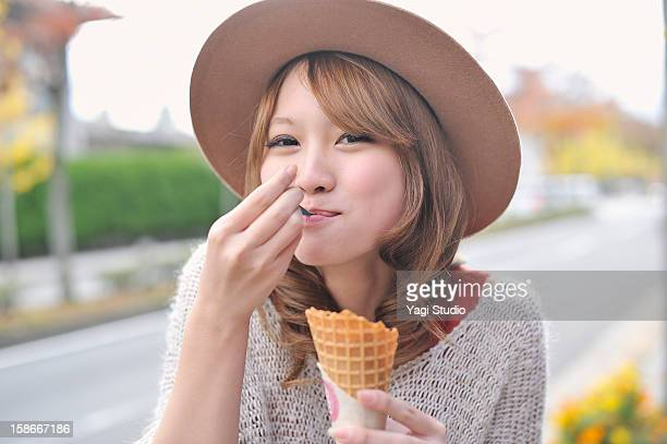 Young woman is eating ice cream