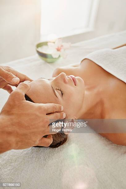 Young woman is receiving beauty treatment