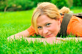 Young woman is relaxing on the grass