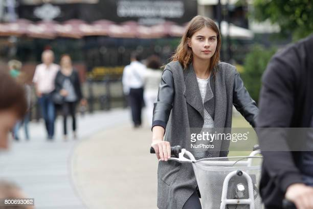 A young woman is seen on a public bike in Bydgoszcz Poland on 24 June 2017 In the last couple of years the city has widely invested in parking...