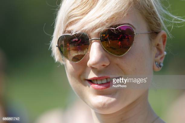 A young woman is seen with heart shaped sunglasses in Myslecinek park n 20 May 2017